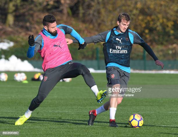 Olivier Giroud and Rob Holding of Arsenal during a training session at London Colney on December 12 2017 in St Albans England