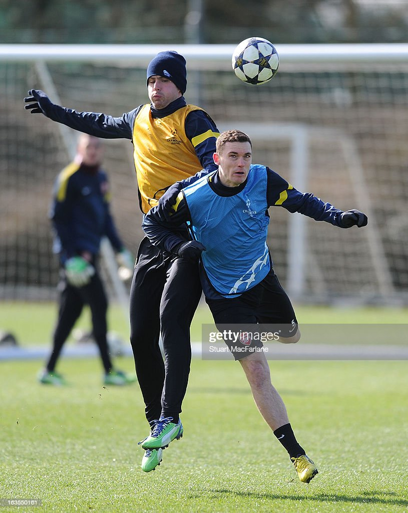 Olivier Giroud and Thomas Vermaelen of Arsenal during a training session at London Colney on March 12, 2013 in St Albans, England.