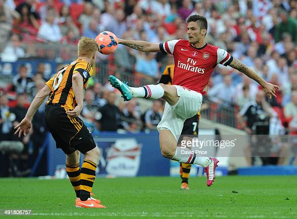 Olivier Giroud Arsenal controls the ball under pressure from Paul McShane of Hull during the match between Arsenal and Hull City in the FA Cup Final...