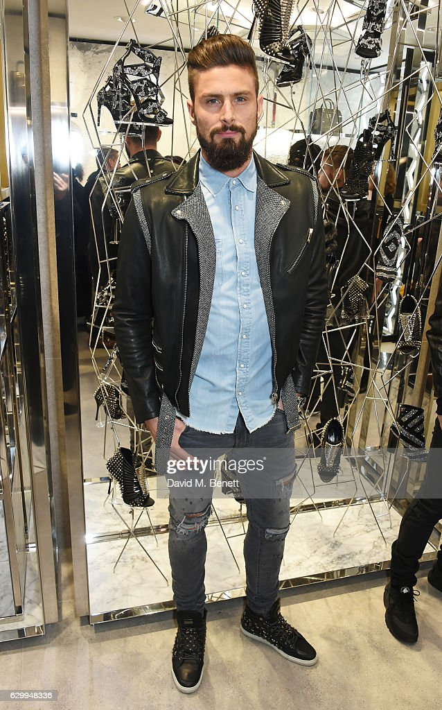Olivier Giroud attends a cocktail party hosted by Philipp Plein to celebrate the opening of the Philipp Plein London boutique on December 15, 2016 in London, England.