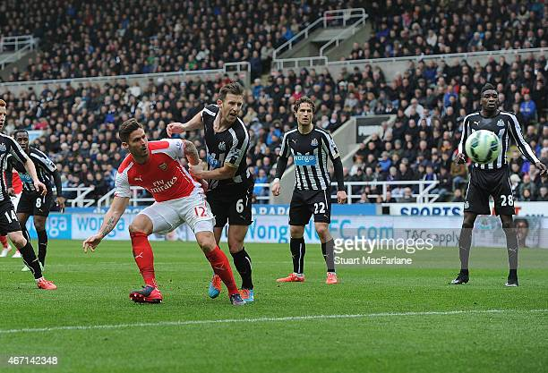 Olivier Giroud beats Newcastle defender Mike Williamson to score the 1st Arsenal goal during the Barclays Premier League match between Newcastle...