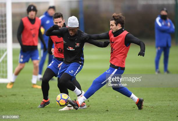 Olivier Giroud Callum Hudson Odoi and Cesc Fabregas of Chelsea during a training session at Chelsea Training Ground on February 2 2018 in Cobham...