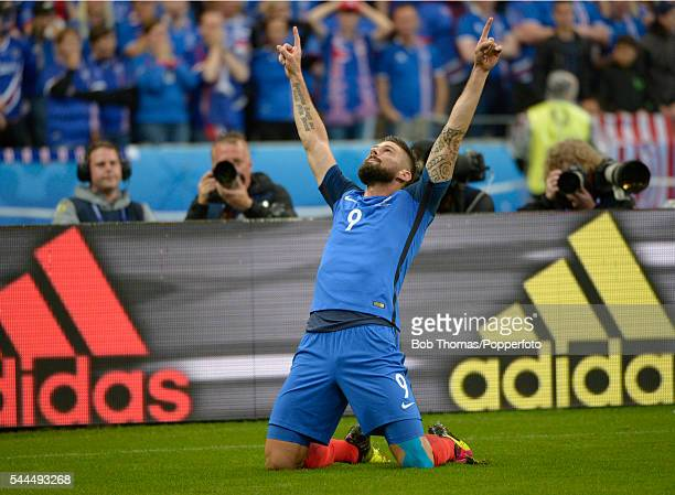 Olivier Giroud celebrates after scoring the first goal for France during the UEFA EURO 2016 quarter final match between France and Iceland at Stade...