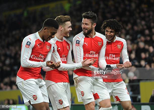 Olivier Giroud celebrates scoring a goal for Arsenal with Alex Iwobi Calum Chambers and Mohamed Elneny during the match between Hull City and Arsenal...