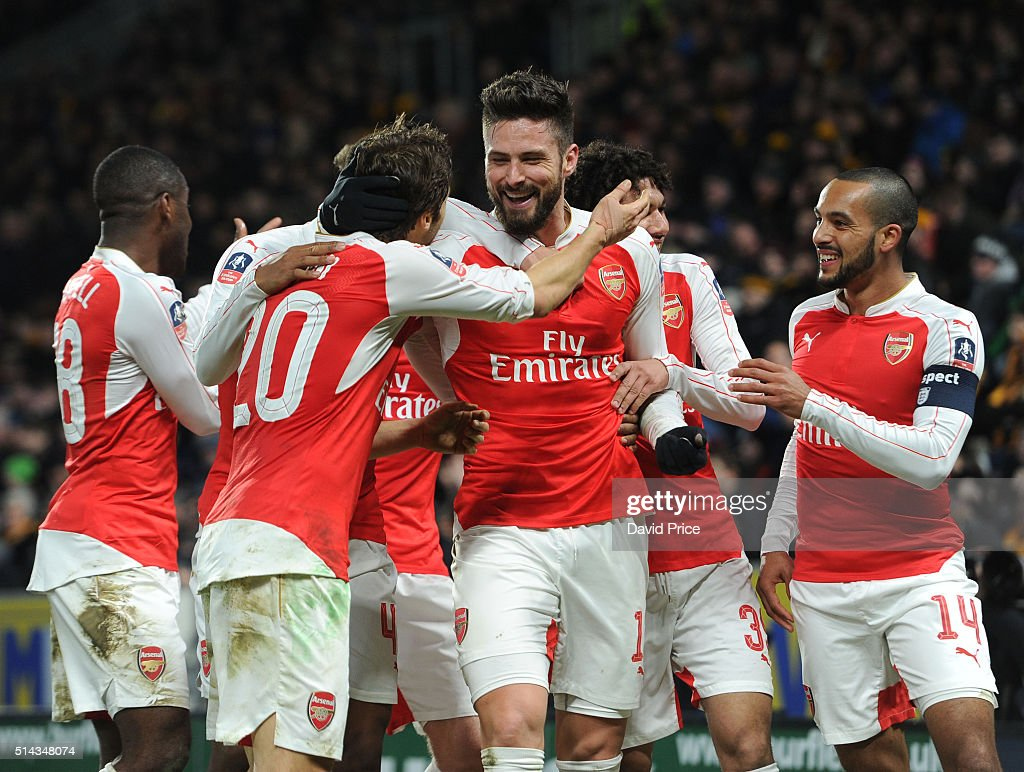 Olivier Giroud celebrates scoring a goal for Arsenal with Mathieu Flamini and Theo Walcott during the match between Hull City and Arsenal in the FA Cup 5th round at KC Stadium on March 8, 2016 in Hull, England.