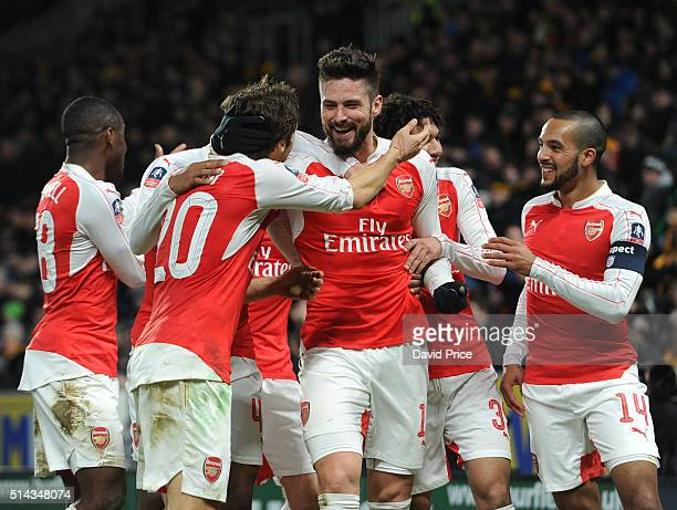 Olivier Giroud celebrates scoring a goal for Arsenal with Mathieu Flamini and Theo Walcott during the match between Hull City and Arsenal in the FA...