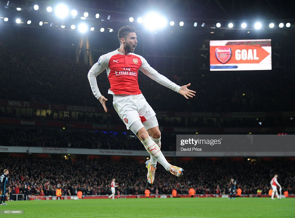 Olivier Giroud celebrates scoring Arsenal's 2nd goal during the Barclays Premier League match between Arsenal and Manchester City at Emirates Stadium on December 21, 2015 in London, England.