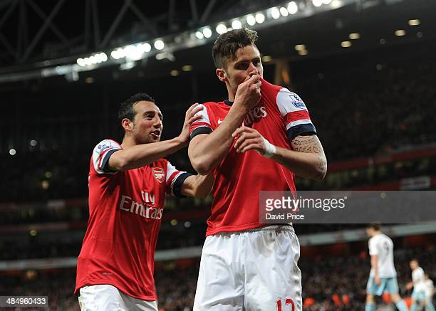Olivier Giroud celebrates scoring Arsenal's 2nd goal with Santi Cazorla during the match between Arsenal and West Ham United in the Barclays Premier...