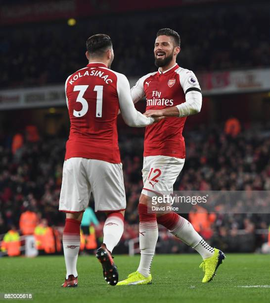 Olivier Giroud celebrates scoring Arsenal's 5th goal with Sead Kolasinac during the Premier League match between Arsenal and Huddersfield Town at...