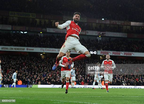 Olivier Giroud celebrates scoring Arsenal's goal during the Premier League match between Arsenal and West Bromwich Albion at Emirates Stadium on...