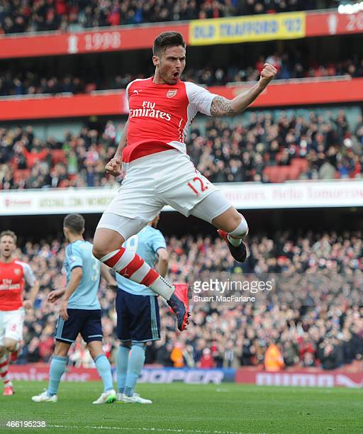 Olivier Giroud celebrates scoring for Arsenal during the Barclays Premier League match between Arsenal and West Ham United at Emirates Stadium on...