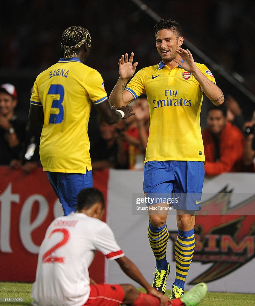 Olivier Giroud celebrates scoring his 1st goal with Bacary Sagna during the match between Arsenal and the Indonesia All-Stars at Gelora Bung Karno Stadium on July 14, 2013 in Jakarta, Indonesia.