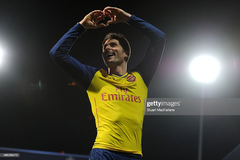 Olivier Giroud celebrates scoring the 1st Arsenal goal during the Barclays Premier League match between Queens Park Rangers and Arsenal at Loftus Road on March 4, 2015 in London, England.