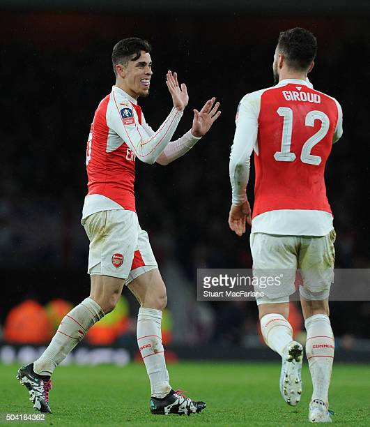 Olivier Giroud celebrates scoring the 3rd Arsenal goal with Gabriel during the Emirates FA Cup Third Round match between Arsenal and Sunderland at...