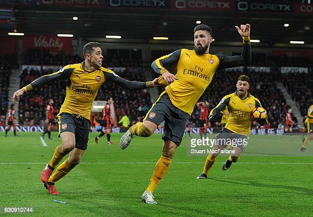 Olivier Giroud celebrates scoring the 3rd Arsenal goal with Gabriel during the Premier League match between AFC Bournemouth and Arsenal at Vitality...