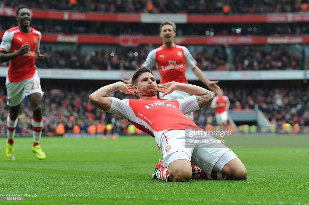 Olivier Giroud celebrates scoring the 4th Arsenal goal during the Barclays Premier League match between Arsenal and Liverpool at Emirates Stadium on April 4, 2015 in London, England.