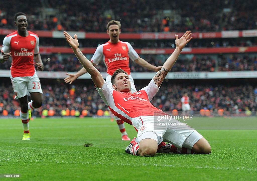 Olivier Giroud celebrates scoring the 4th Arsenal goal during the Barclays Premier League match between Arsenal and Liverpool at Emirates Stadium on April 4, 2015 in London, England. Photo by Stuart MacFarlane/Arsenal FC via Getty Images)