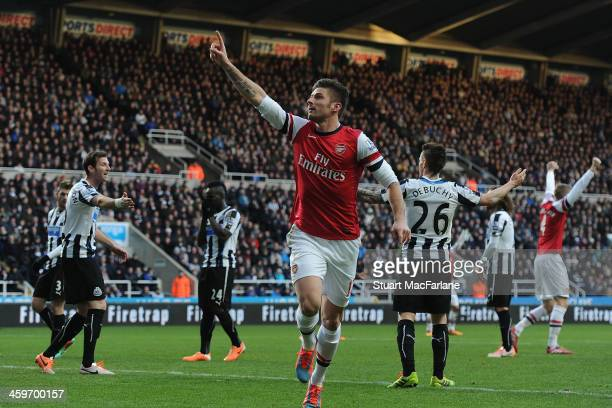 Olivier Giroud celebrates scoring the Arsenal goal during the Barclays Premier League match between Newcastle United and Arsenal at St James' Park on...