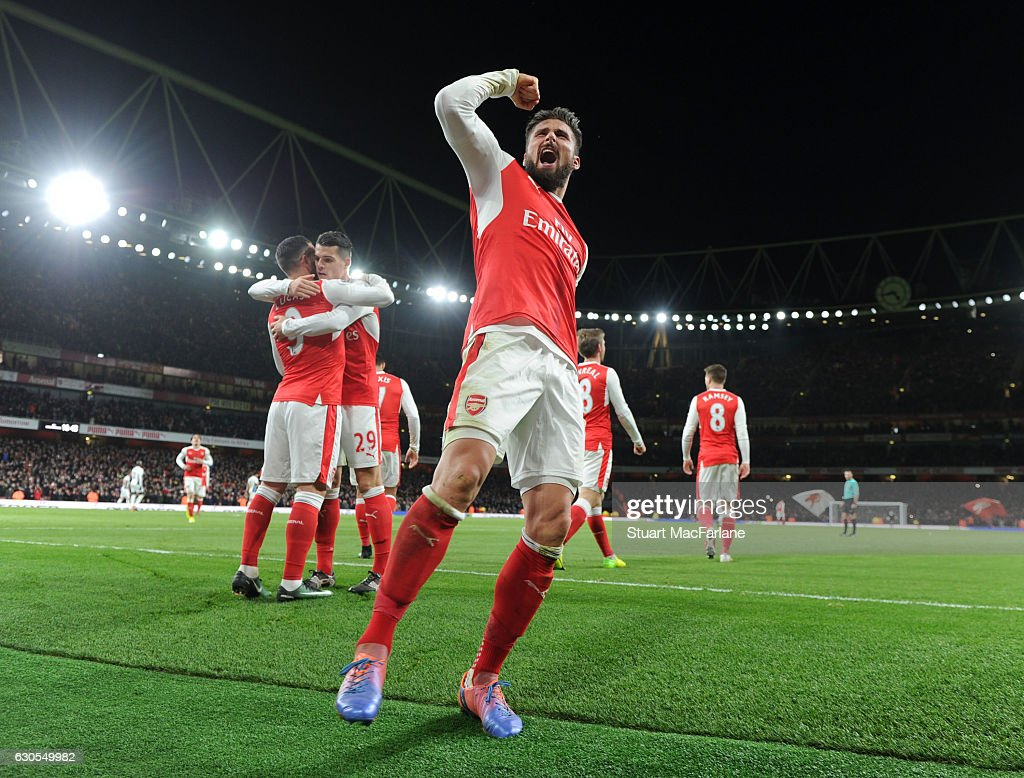 Olivier Giroud celebrates scoring the Arsenal goal during the Premier League match between Arsenal and West Bromwich Albion at Emirates Stadium on December 26, 2016 in London, England.