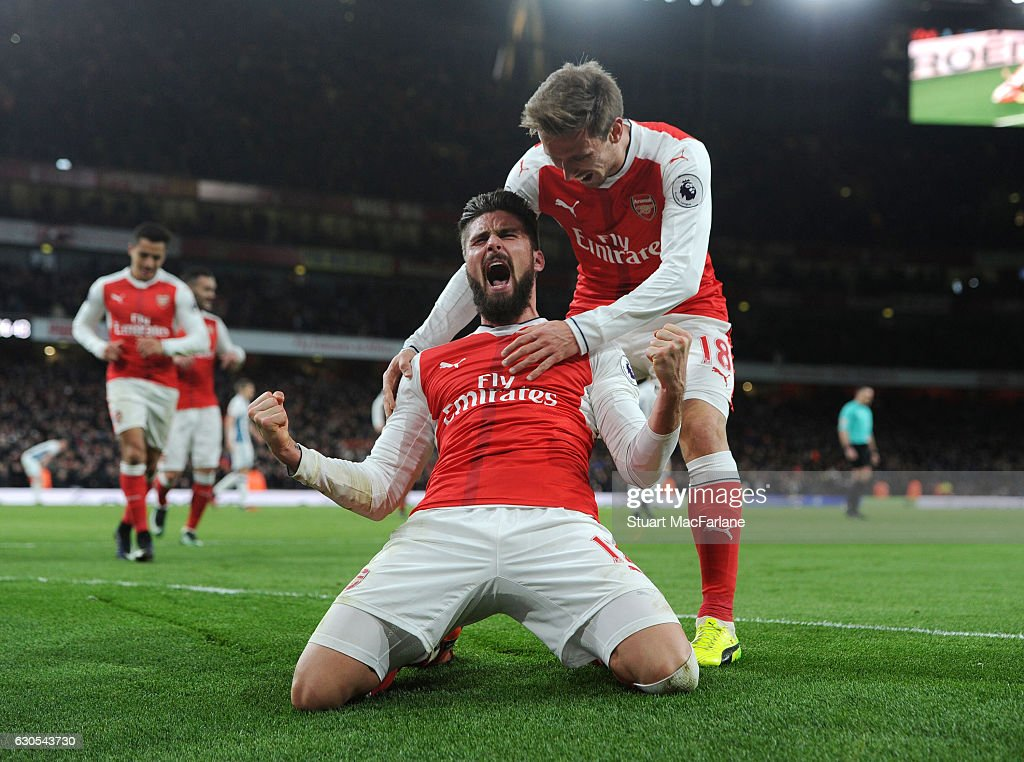 Olivier Giroud celebrates scoring the Arsenal goal with (R) Nacho Monreal the Premier League match between Arsenal and West Bromwich Albion at Emirates Stadium on December 26, 2016 in London, England.