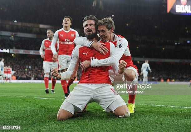 Olivier Giroud celebrates scoring the Arsenal goal with Nacho Monreal the Premier League match between Arsenal and West Bromwich Albion at Emirates...