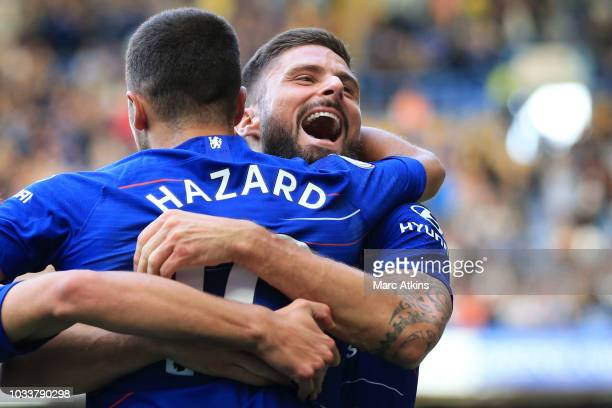 Olivier Giroud celebrates with Eden Hazard of Chelsea during the Premier League match between Chelsea FC and Cardiff City at Stamford Bridge on...