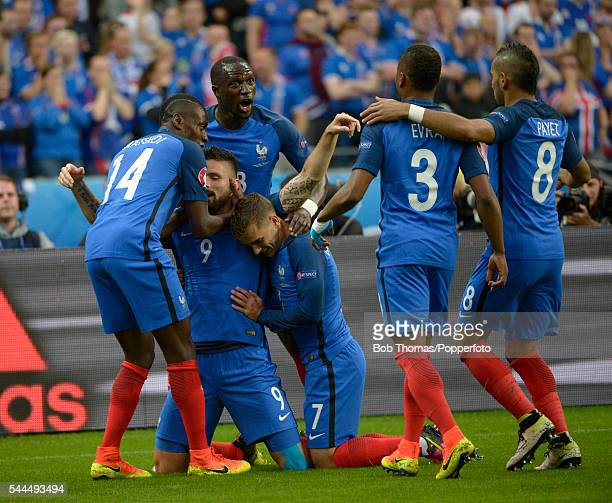 Olivier Giroud celebrates with teammates after scoring the first goal for France during the UEFA EURO 2016 quarter final match between France and...