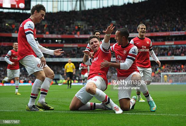 Olivier Giroud celebrates with teammates Theo Walcott and Laurent Koscielny after scoring their team's third goal during the Barclays Premier League...