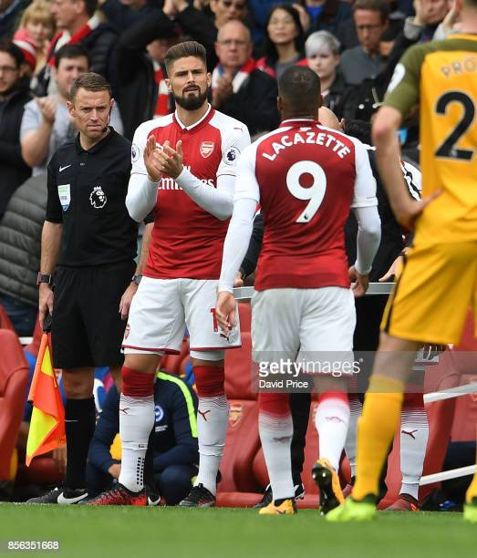 Olivier Giroud comes on for Alexandre Lacazette of Arsenal during the Premier League match between Arsenal and Brighton and Hove Albion at Emirates...