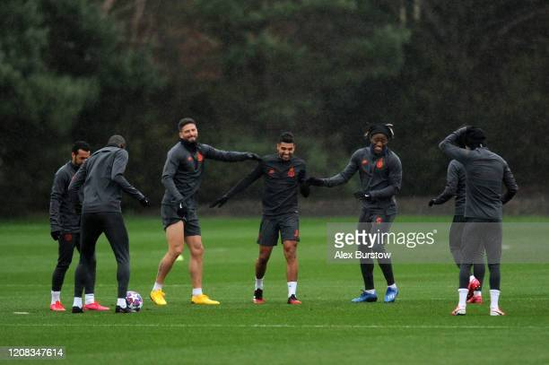 Olivier Giroud Emerson and Michy Batshuayi of Chelsea share a joke during a training session ahead of their UEFA Champions League Round of 16 first...