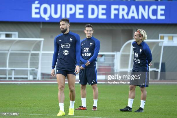 Olivier Giroud Florian Thauvin and Antoine Griezmann of France react during a France training session on October 3 2017 in Clairefontaine France