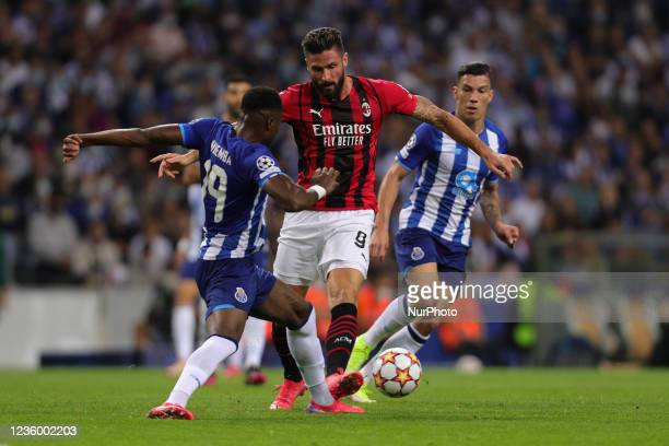 Olivier Giroud forward of AC Milan vies with Portos Congolese defender Chancel Mbemba during the UEFA Champions League Group stage - Group B match...