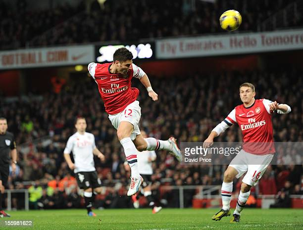 Olivier Giroud heads his 2nd goal Arsenal's 3rd during the Barclays Premier League match between Arsenal and Fulham at Emirates Stadium on November...