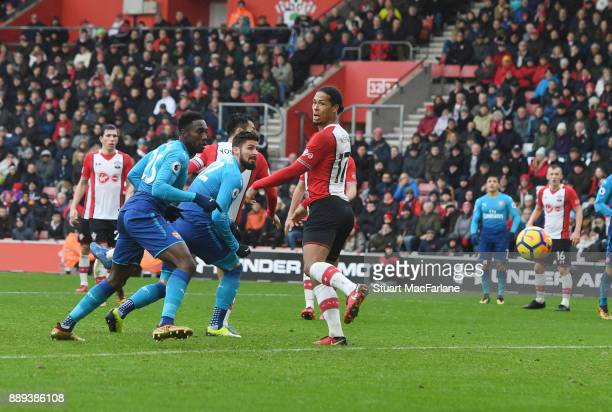 Olivier Giroud heads past Southampton defender Virgil Van Dijk to score the Arsenal goal during the Premier League mat ch between Southampton and...