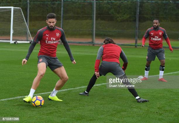 Olivier Giroud Hector Bellerin and Alex Lacazette of Arsenal during a training session at London Colney on November 4 2017 in St Albans England