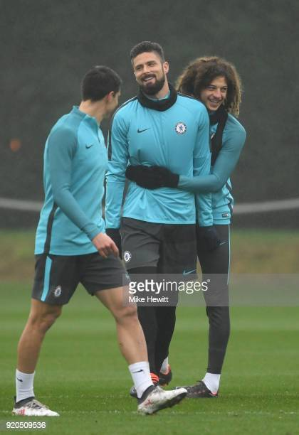 Olivier Giroud is embraced by Ethan Ampadu of Chelsea during a training session at Chelsea Training Ground on February 19 2018 in Cobham England