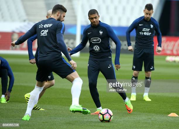 Olivier Giroud, Kylian Mbappe of France during the training session on the eve of the international friendly match between France and Spain at Stade...
