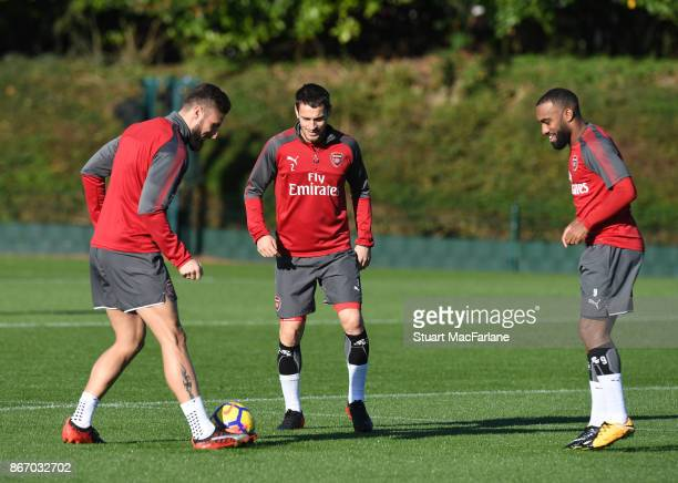 Olivier Giroud Mathieu Debuchy and Alex Lacazette of Arsenal during a training session at London Colney on October 27 2017 in St Albans England