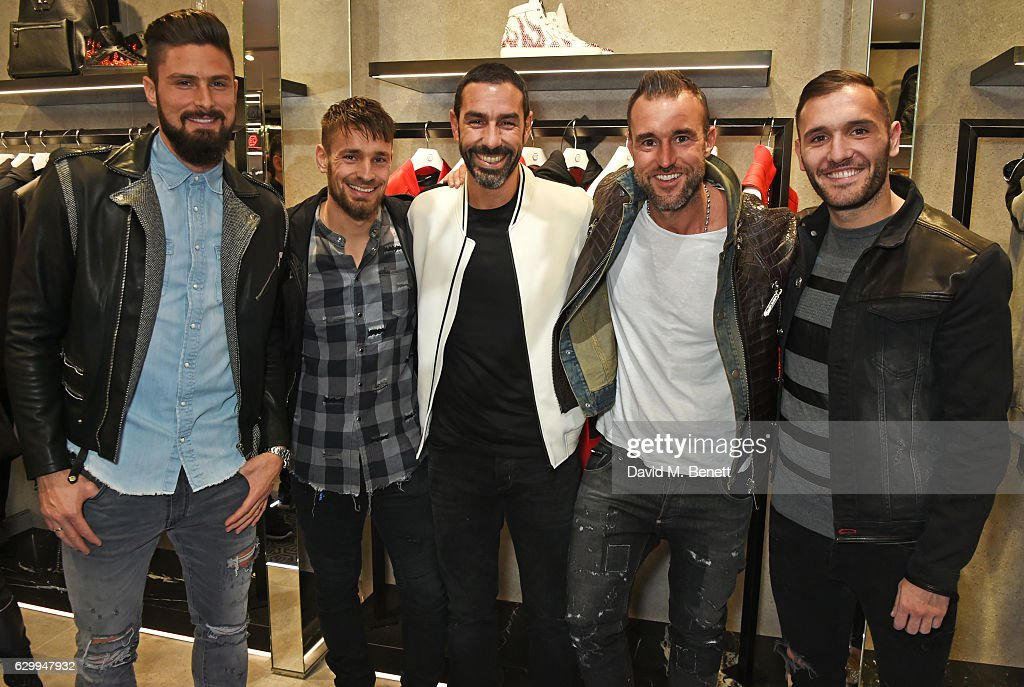 Olivier Giroud, Mathieu Debuchy, Robert Pires, Philipp Plein and Lucas Perez attend a cocktail party hosted by Philipp Plein to celebrate the opening of the Philipp Plein London boutique on December 15, 2016 in London, England.