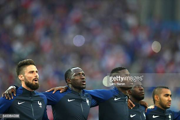 Olivier Giroud Moussa Sissoko Paul Pogba Samuel Umtiti and Dimitri Payet of France line up for the national anthem prior to the UEFA EURO semi final...