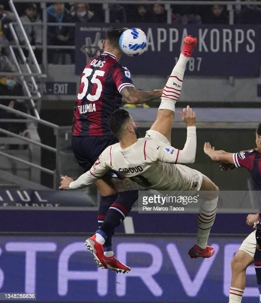 Olivier Giroud of AC Milan competes for the ball with Dijks Mitchell of Bologna FC during the Serie A match between Bologna FC and AC Milan at Stadio...