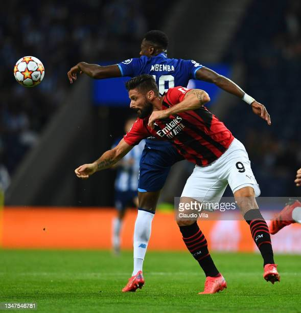 Olivier Giroud of AC Milan competes for the ball with Mbemba of FC Porto during the UEFA Champions League group B match between FC Porto and AC Milan...