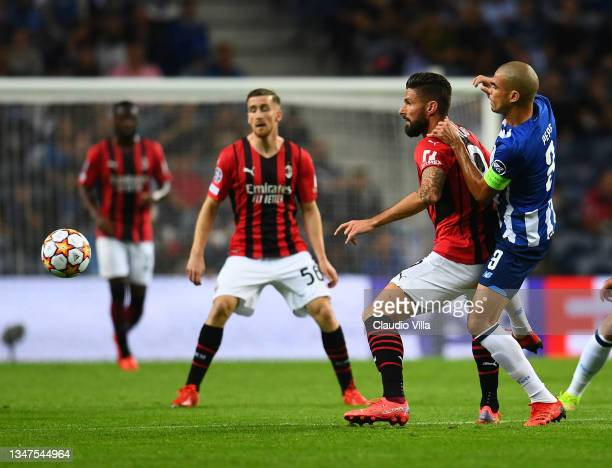 Olivier Giroud of AC Milan competes for the ball with Pepe of FC Porto during the UEFA Champions League group B match between FC Porto and AC Milan...