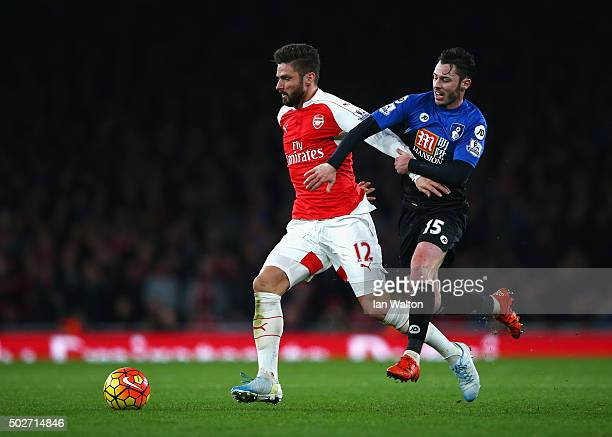 Olivier Giroud of Arsenal and Adam Smith of Bournemouth compete for the ball during the Barclays Premier League match between Arsenal and AFC...