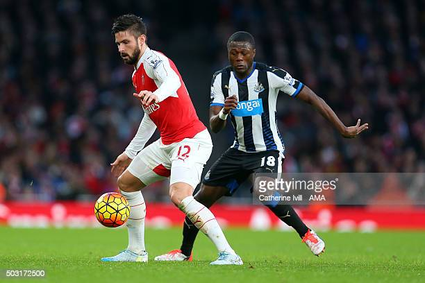 Olivier Giroud of Arsenal and Chancel Mbemba of Newcastle United during the Barclays Premier League match between Arsenal and Newcastle United at...