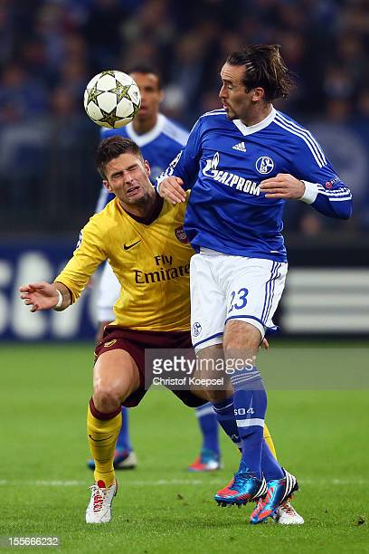 Olivier Giroud of Arsenal and Christian Fuchs of Schalke go up for a header during the UEFA Champions League group B match between FC Schalke 04 and...