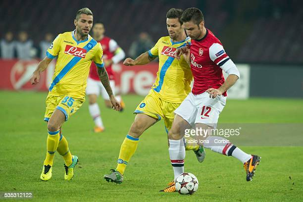 Olivier Giroud of Arsenal and Christian Maggio in action during the UEFA Champions League Group F match between SSC Napoli and Arsenal at Stadio San...