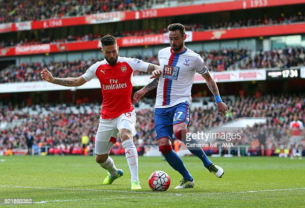 Olivier Giroud of Arsenal and Damien Delaney of Crystal Palace during the Barclays Premier League match between Arsenal and Crystal Palace at the...