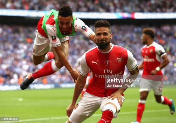 Olivier Giroud of Arsenal and Francis Coquelin of Arsneal celebrate their sides second goal during the Emirates FA Cup Final between Arsenal and...