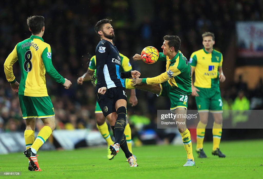 Olivier Giroud of Arsenal and Gary O'Neil of Norwich City battle for the ball during the Barclays Premier League match between Norwich City and Arsenal at Carrow Road on November 29, 2015 in Norwich, England.